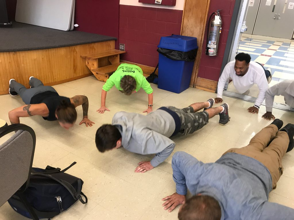Veterans doing push-ups in dining hall