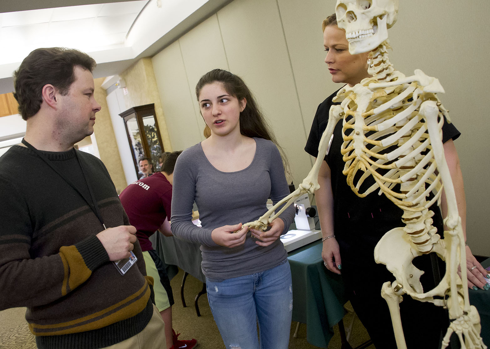 professor and student with learning skeleton