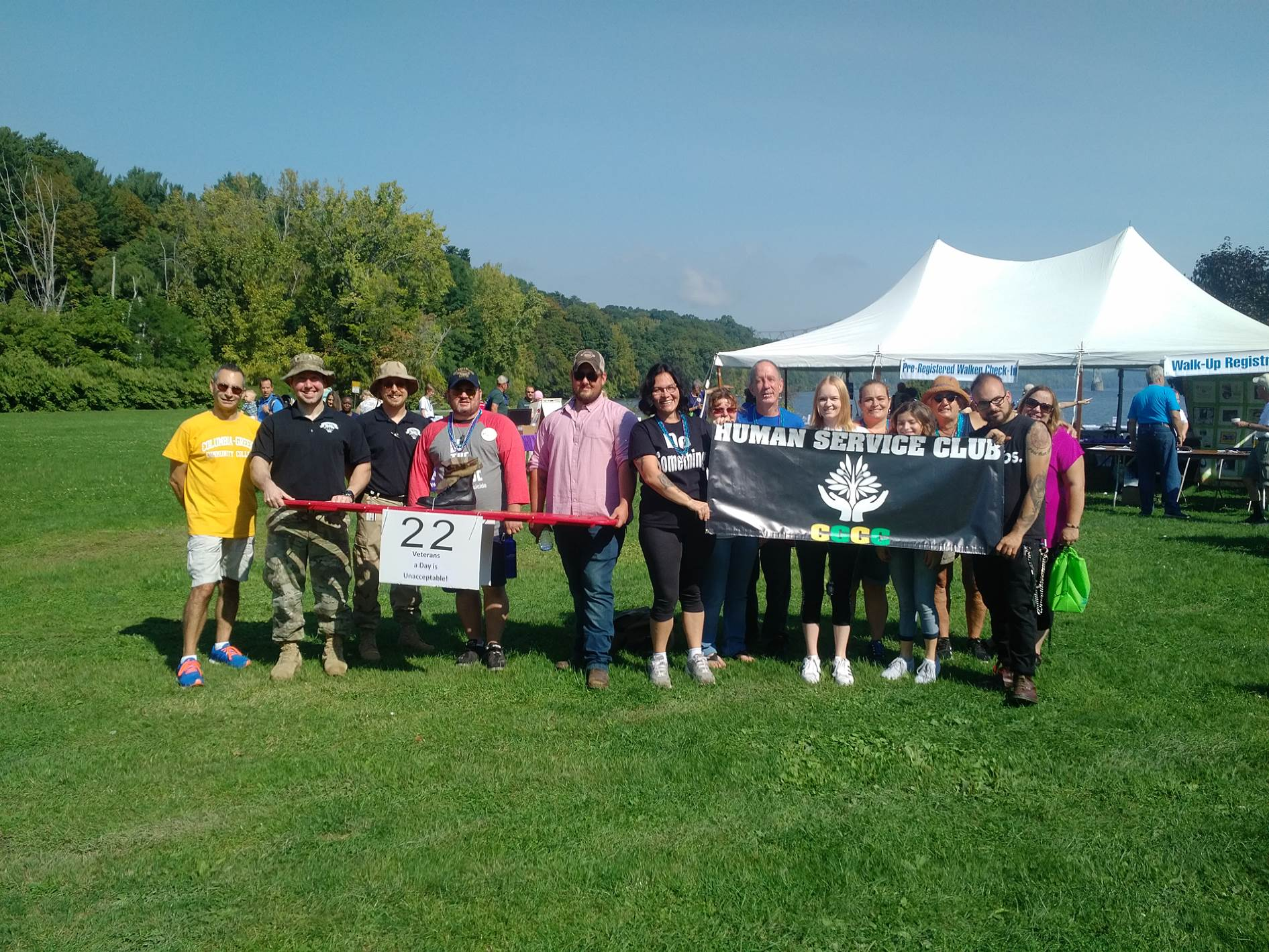 Group of students and professors at an outdoor fundraising walk