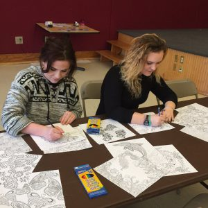 Pop-up event with two students adult coloring