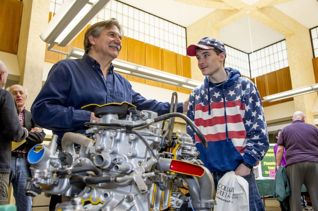 Professor and Student in front of a car engine