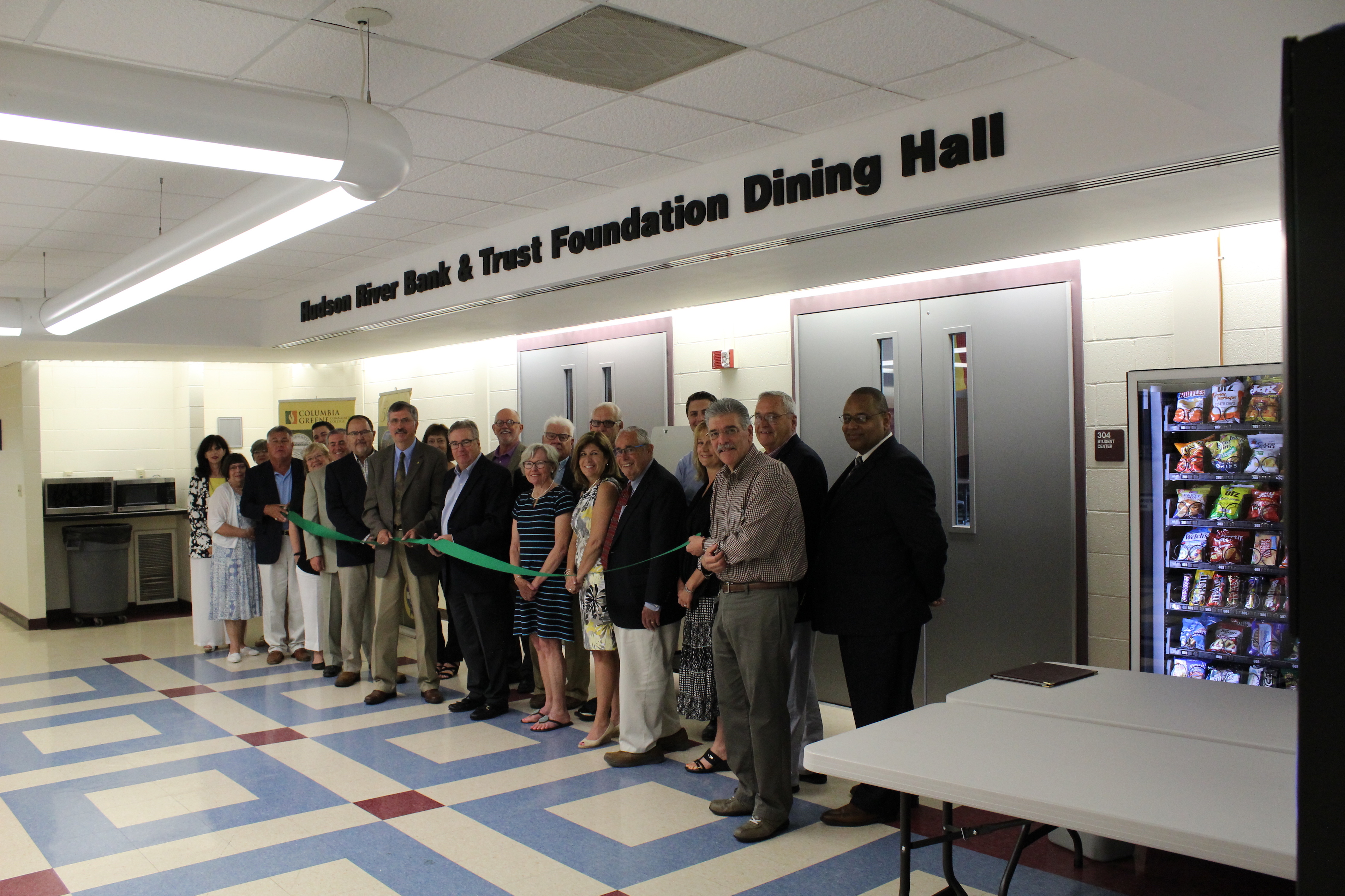 Ribbon cutting in front of newly named dining hall