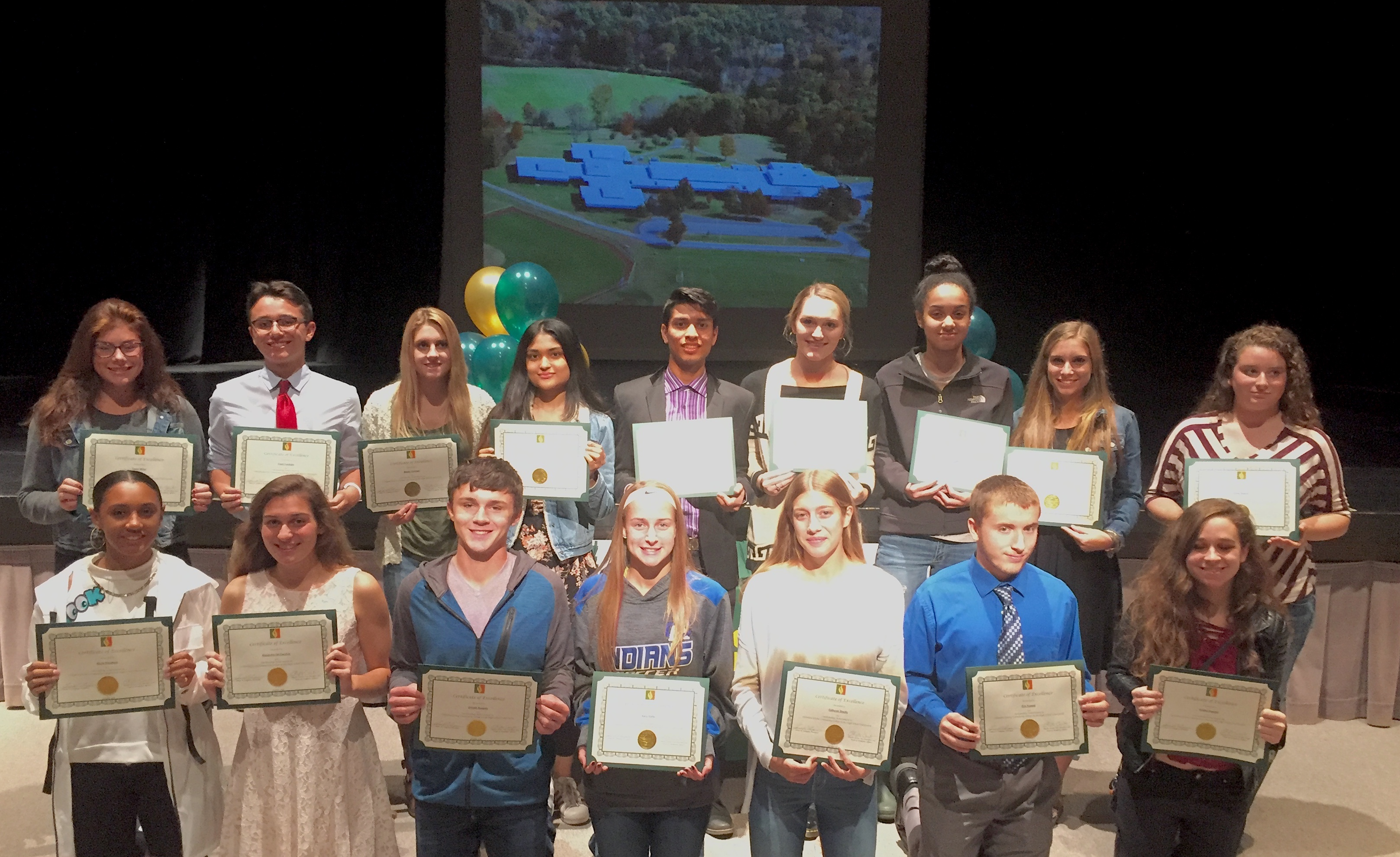 high school students pose with certificates of excellence
