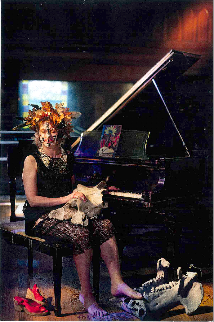 Fine Art photo by Richard Edelman - woman at piano with leaves and animal skull