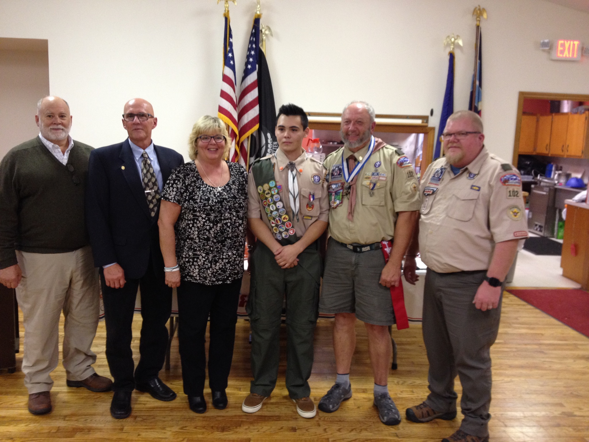 Eagle Scout with family and Scoutmasters