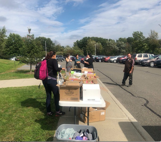 students select food from mobile food pantry