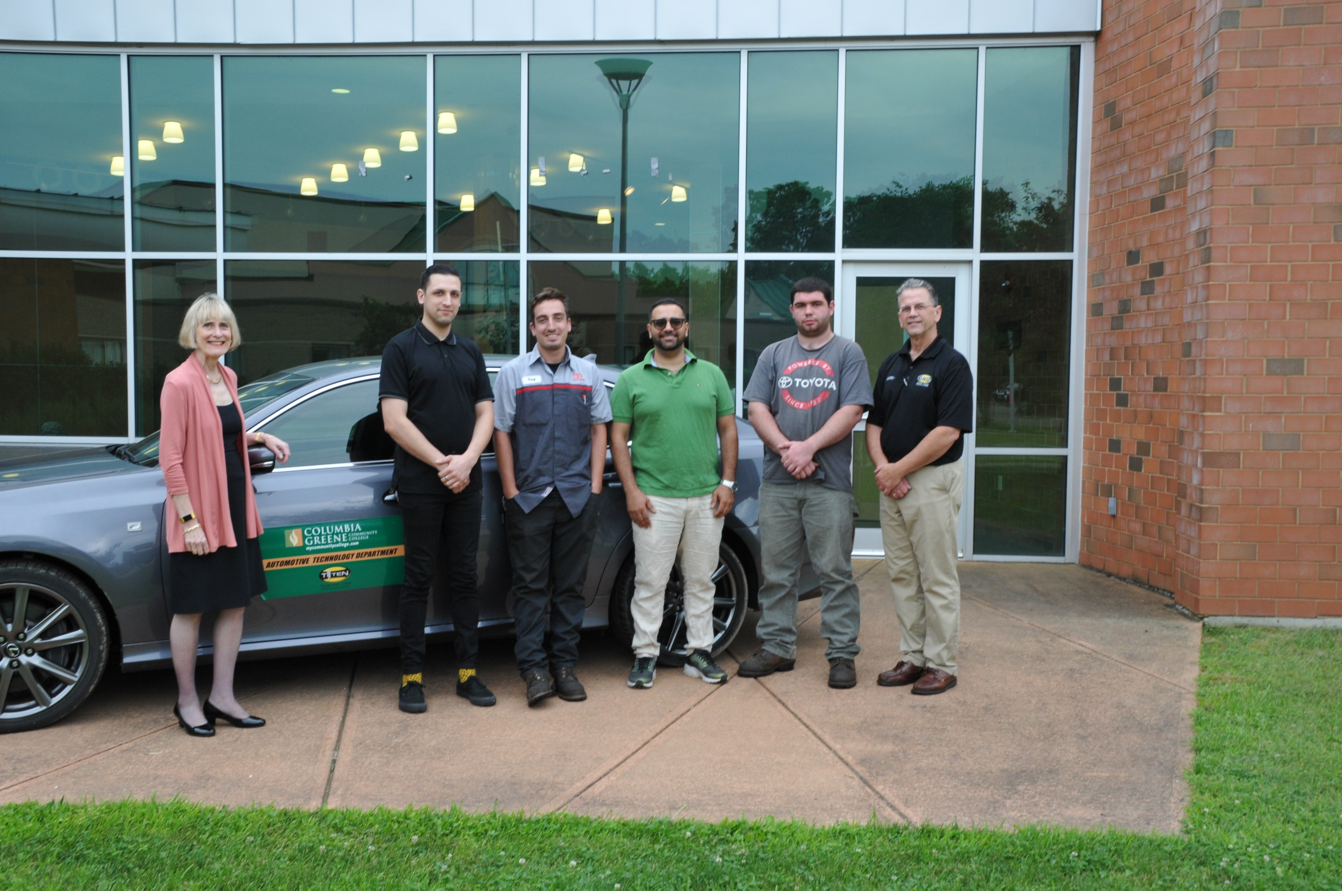 Toyota TTEN class of 2019 in front of a the college's automotive technology work-car, a Lexus