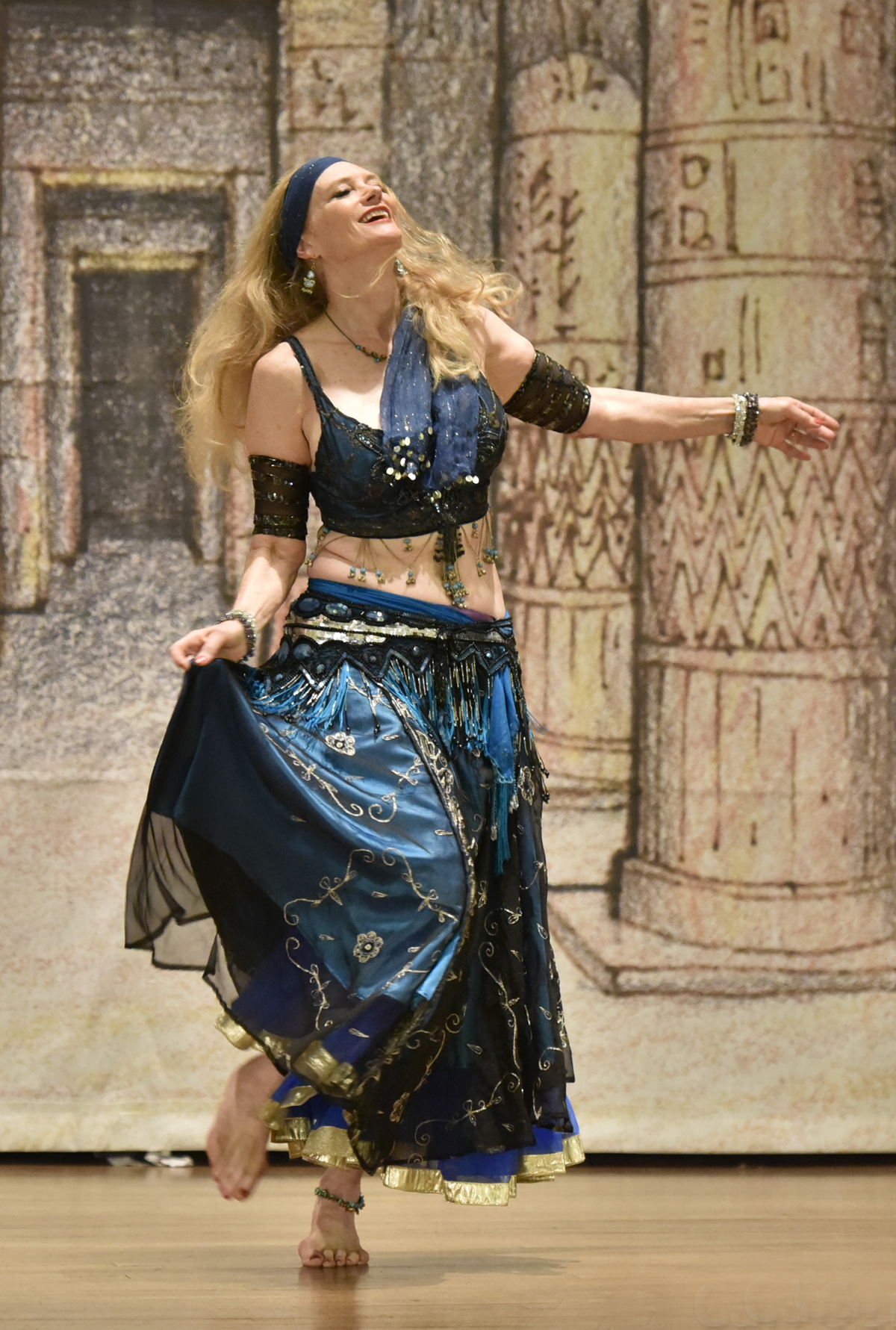 Woman with long blonde hair belly dancing
