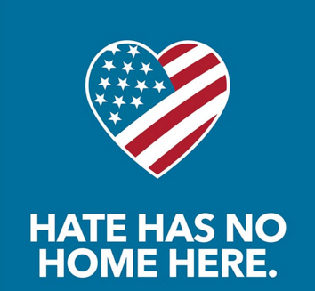 Hate Has No Home Here sign with heart decorated as an american flag
