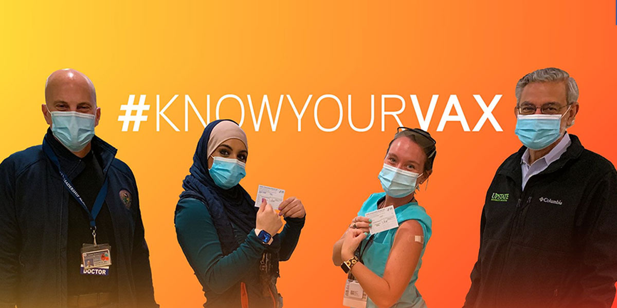 Four people on an orange backdrop; two are masculine and two are feminine. All are wearing masks. The words Know Your Vax are on the top